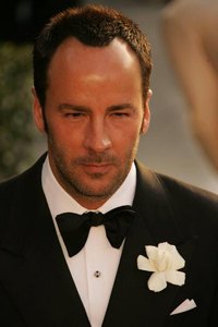 Tom Ford with black tux and white flower